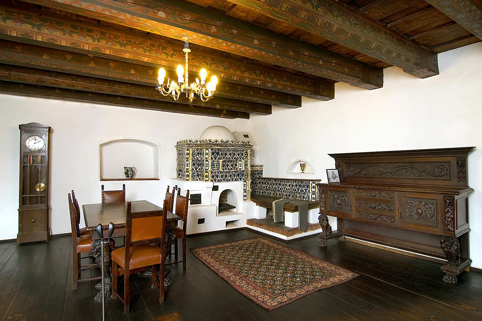 Ornamental motifs are carved out in the furniture or painted on the massive ceiling beams