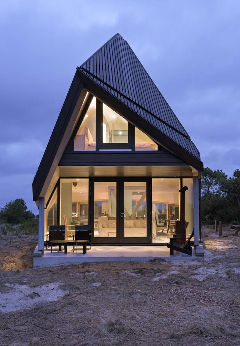 The roof has an asymmetrical design which suits the house well given its surroundings