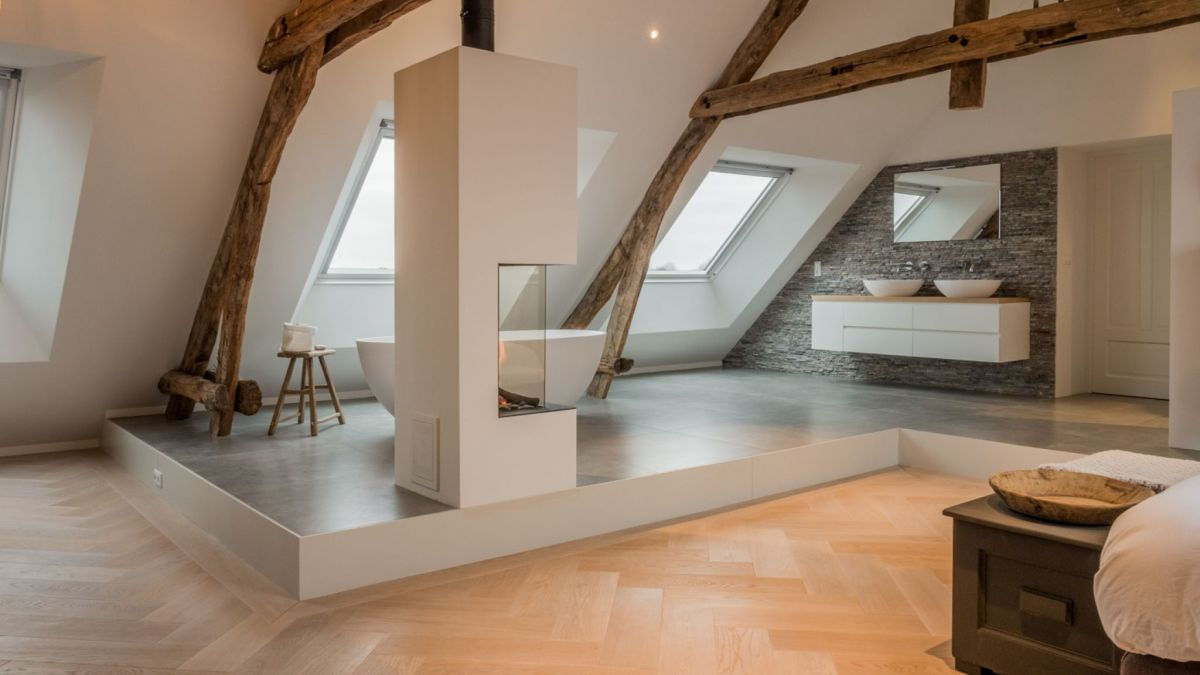 The original shape of the roof was preserved, giving the upstairs area a really cozy look