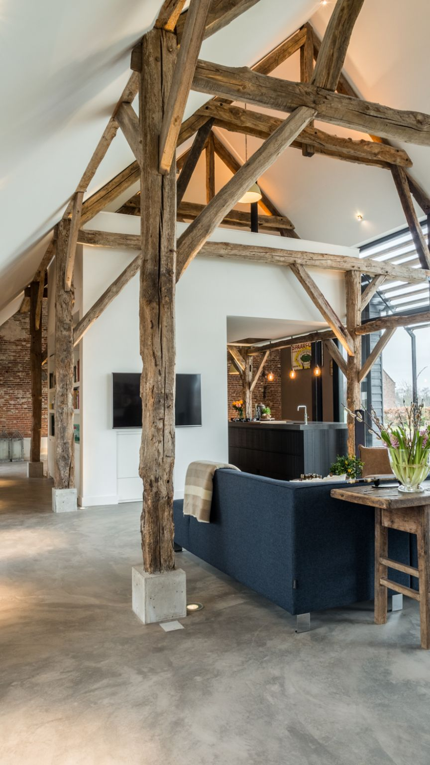 The high ceiling and exposed wooden beams are a wonderful combination which gives the living area lots of character