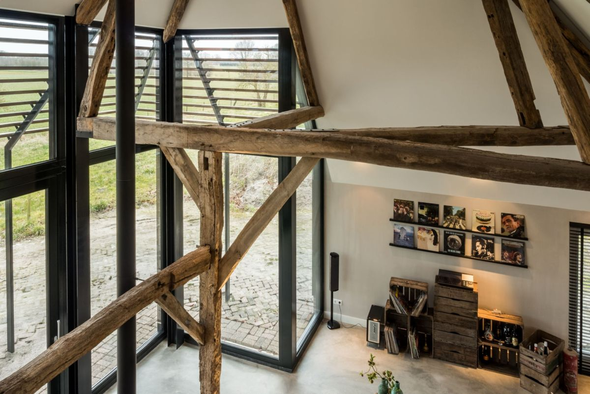 New large windows and glass doors create a strong connection between the house and its immediate surroundings