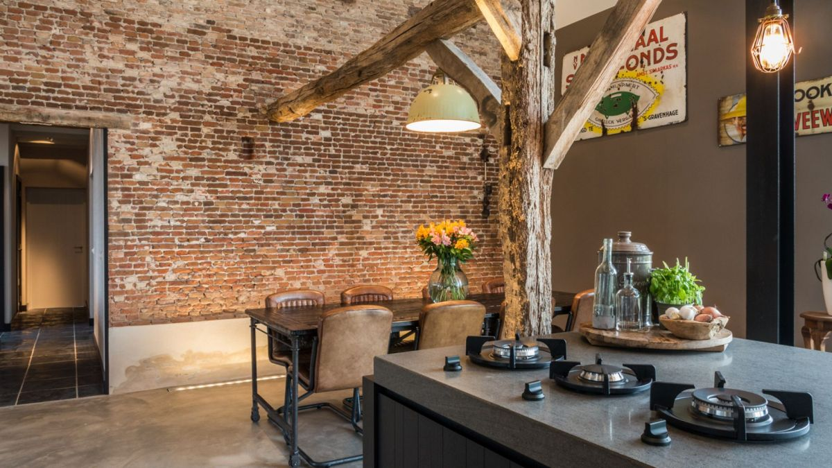 The brick wall was left exposed and empty, becoming a focal point for the entire house
