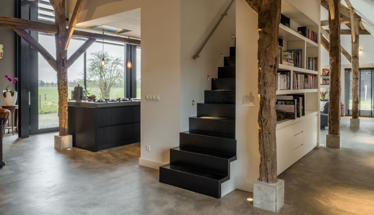 The staircase is cleverly hidden behind bookshelves, maintaining a low profile