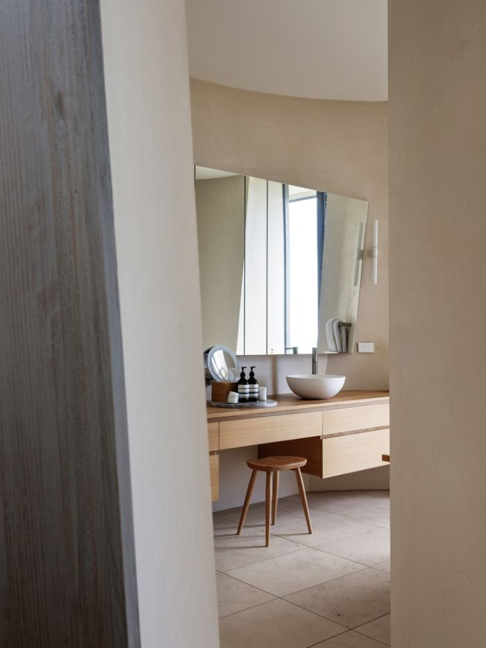 The bathroom is also housed inside a cylinder and is actually quite spacious