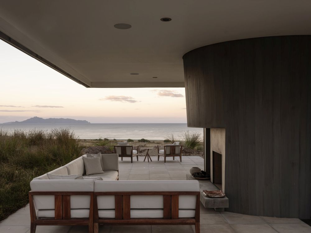 The outdoor lounge area is sheltered beneath the cantilevered roof
