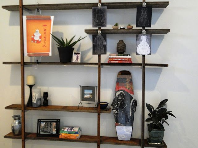 Floating wall shelves using reclaimed wood