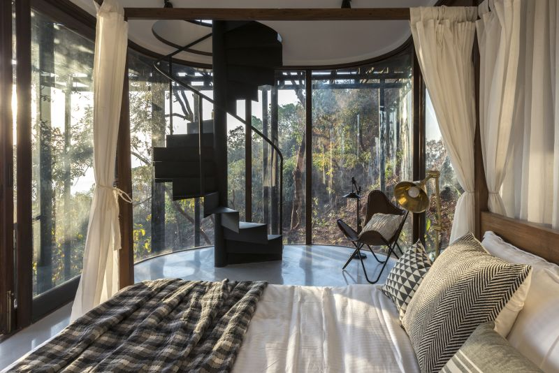 The staircase drops into another bedroom, equally tranquil and serene