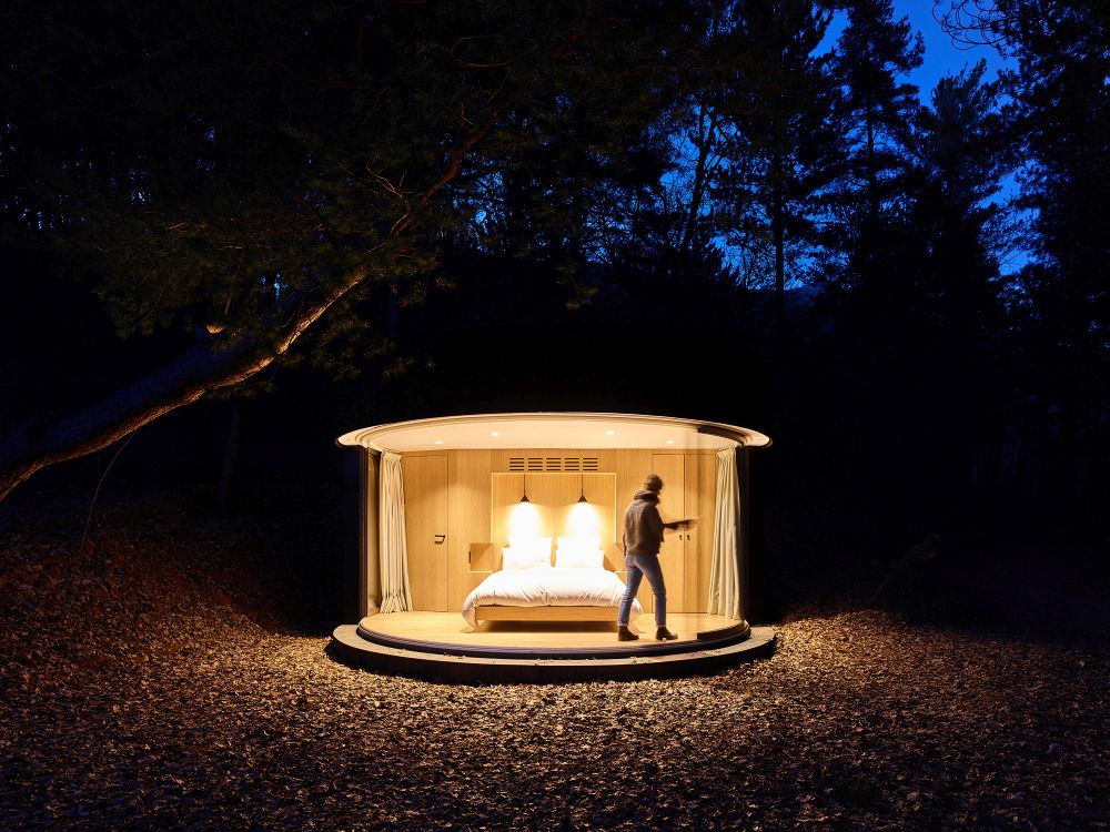 The curved window runs along rails and can open up completely, exposing the bedroom to the outdoors