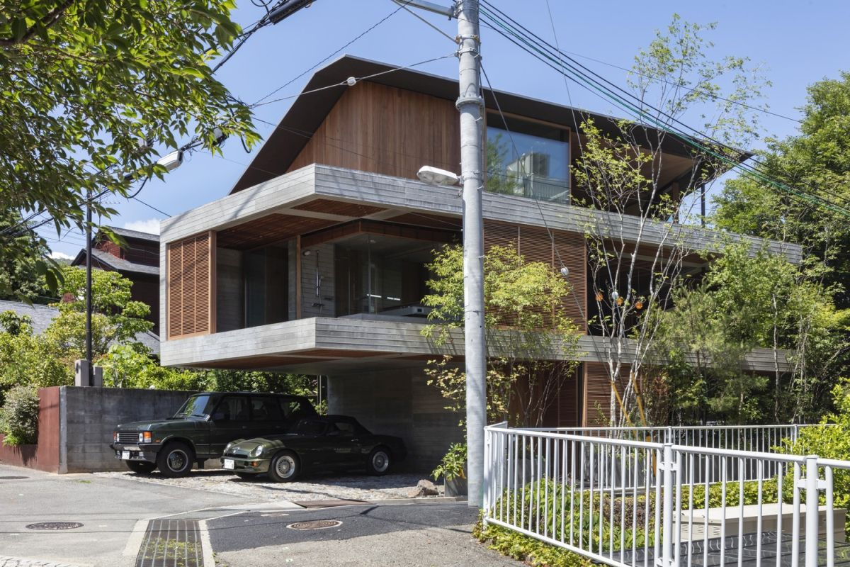 The concrete surfaces are complemented by lots of warm wood throughout the exterior