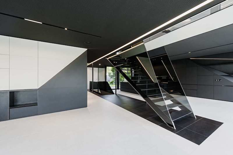 Black and white and two main colors that were used in the interior design of this futuristic house