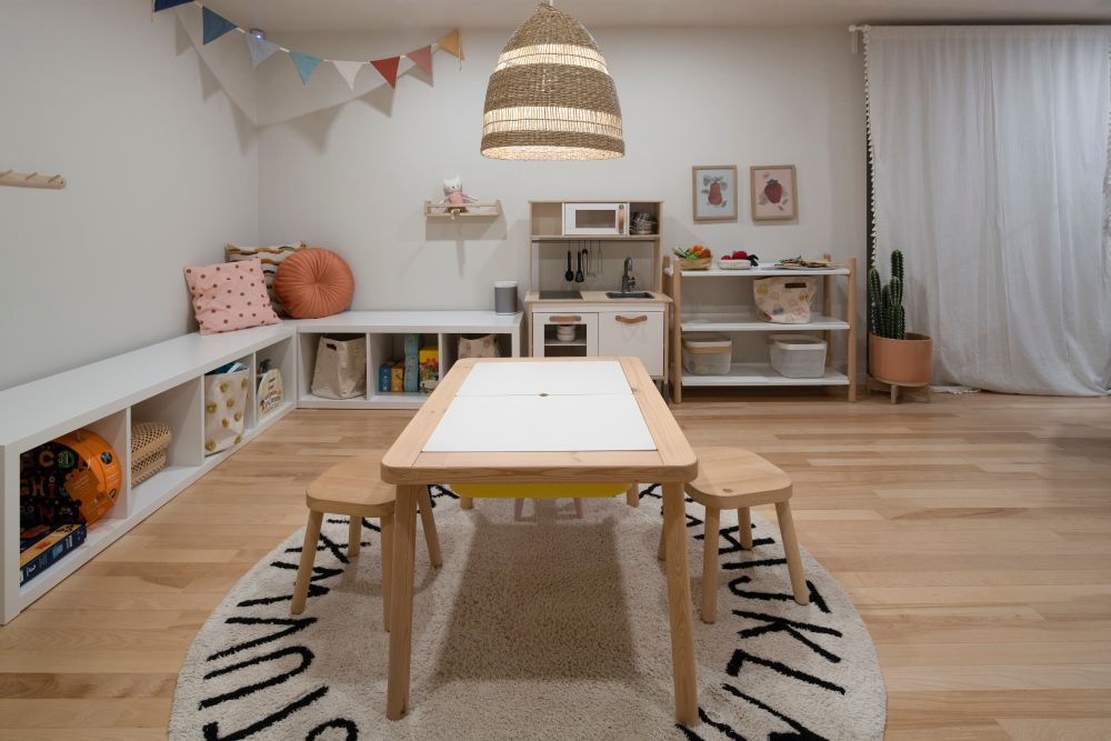 There's a nice activity area in the playroom with a table and a couple of small chairs