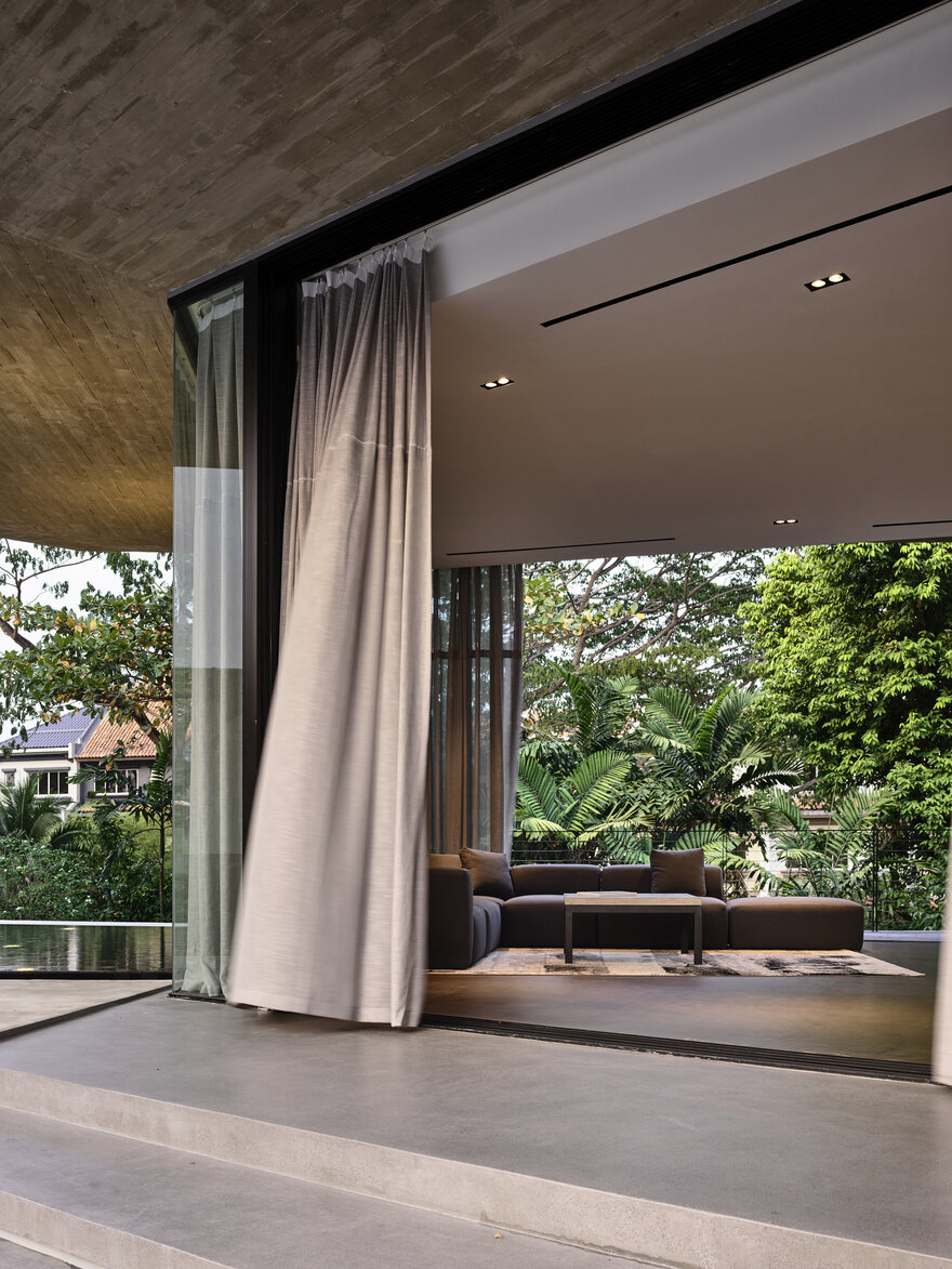 Long fabric curtains add texture to the interior design and also create a welcoming and comfortable ambiance