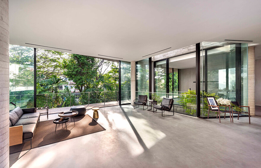 The full-height windows and large glass doors let in lots of sunlight while also letting the outdoors in