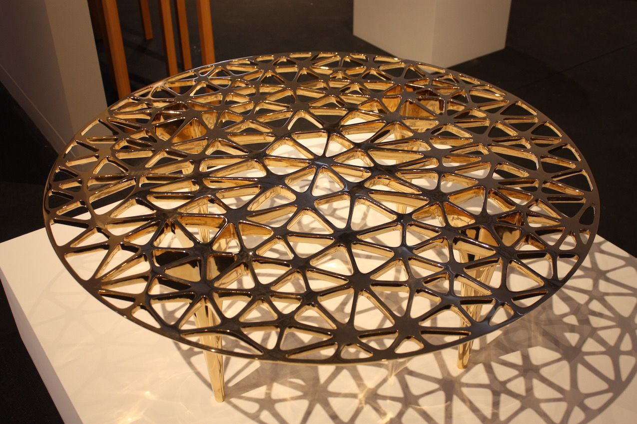 """Again focusing on geometric lines, designer Janne Kyttanen created this magnificent polished bronze tabletop. Finnish artist Kyttanen is a """"digital sculptor creating multidisciplinary work at the intersection of 3D printing, virtual & augmented reality."""""""