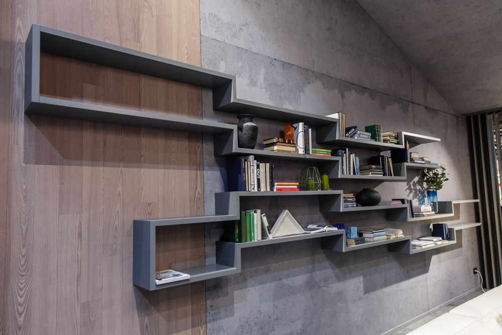 Instead of several individual shelves you could have a shelving unit that seamlessly links the shelves together