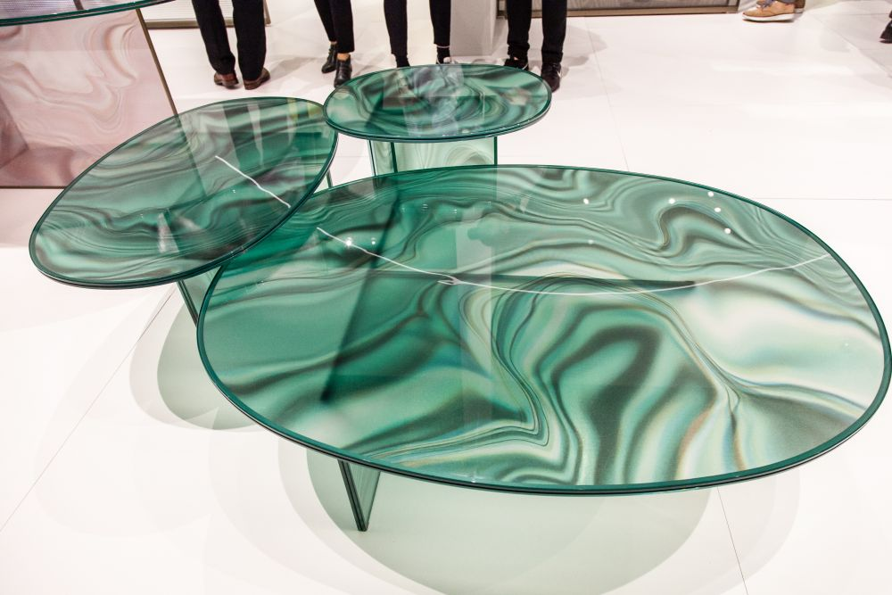 The Liquefy coffee tables are made entirely of glass and their tops mimic the look of marble