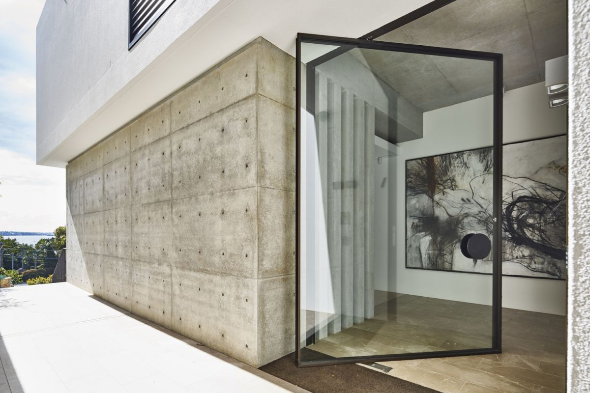 Glass doors that pivot help fuse the outdoors with the indoors.