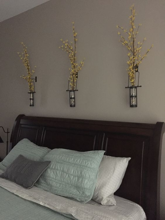 Glass flowers above the bed