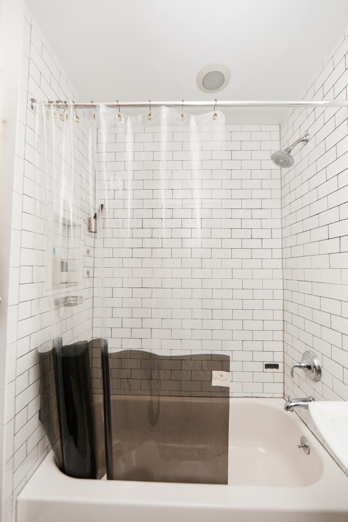 Go with a Clear Shower Curtain