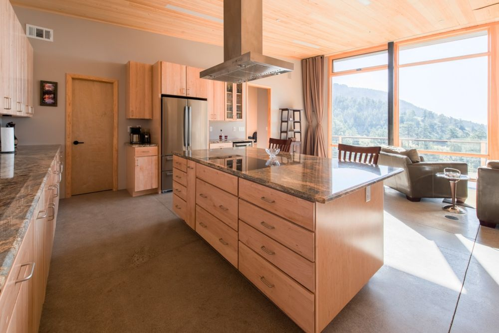 The kitchen is large and has an open-concept design which adds a very casual vibe to the whole house