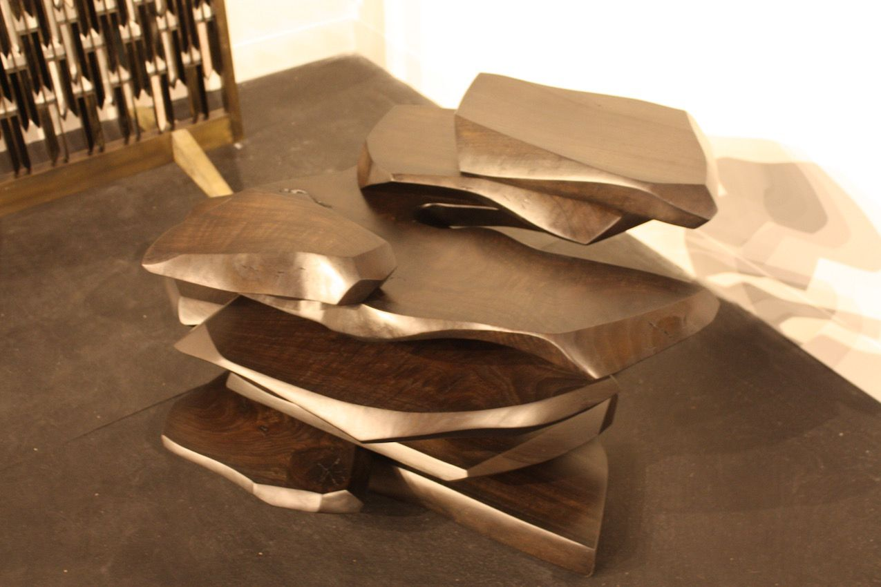 While it might look metallic, this stacked side table, by artist Stephen Bishop is made of walnut. It is available at the Cristina Grajales Gallery.