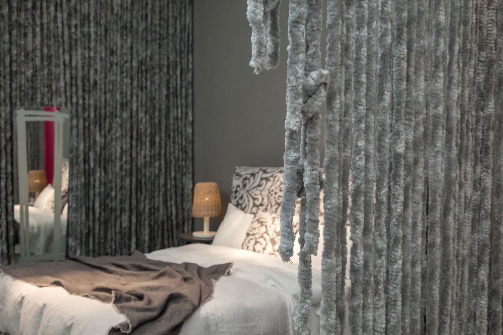 Texture is very important in a bedroom. Soft and cozy textures give the space a warm and welcoming feel