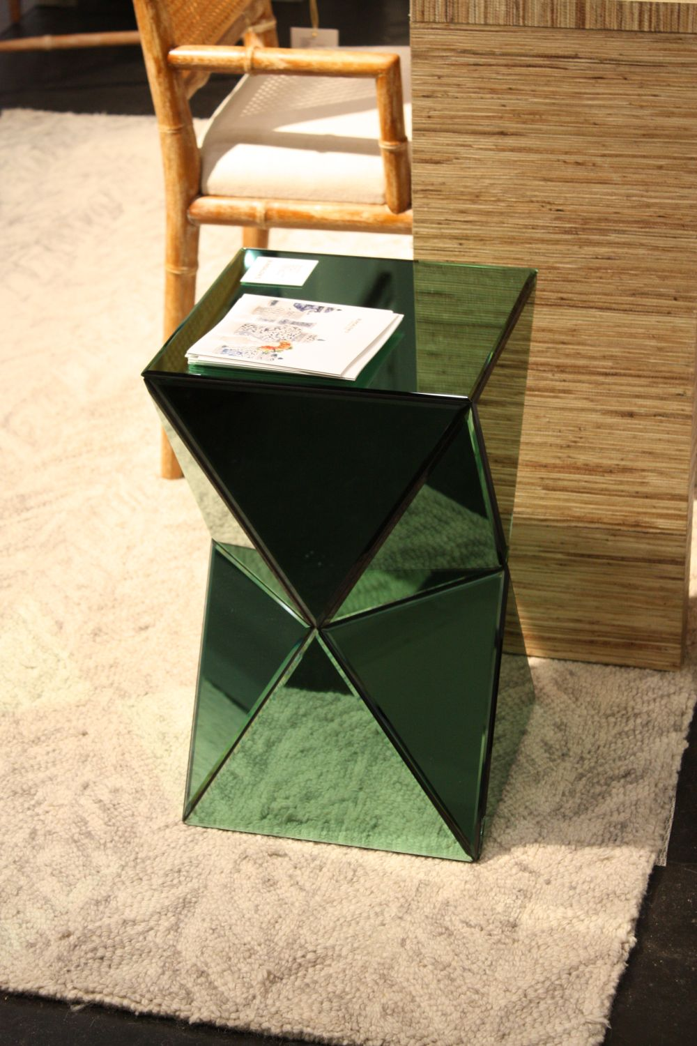 This side table reflects the decor around it through a green filter