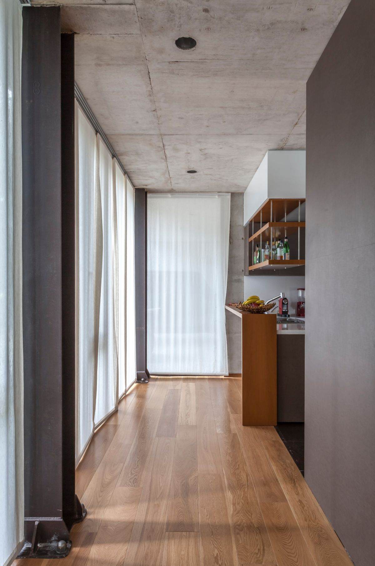 The hall to the kitchen offers a look at the various design details.