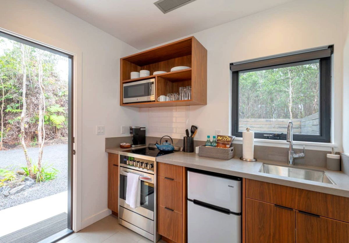 The kitchen is equipped with basic appliances and sufficient storage