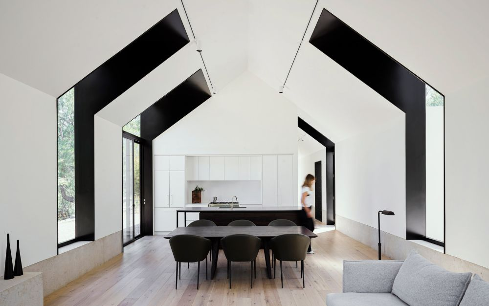 The windows are offset and that results in an asymmetrical design