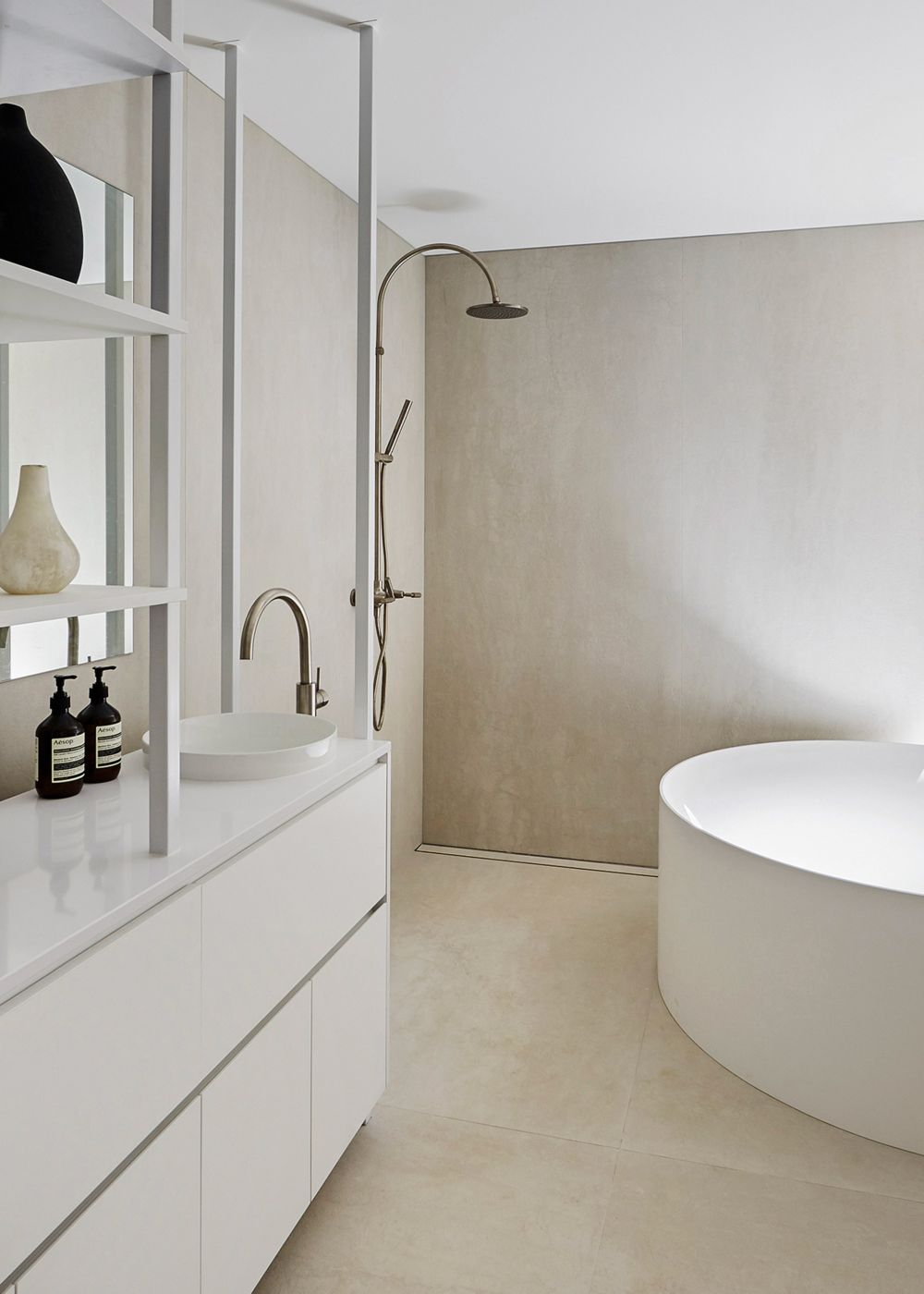 White is the predominant color featured throughout the house, complemented by black and warm neutrals