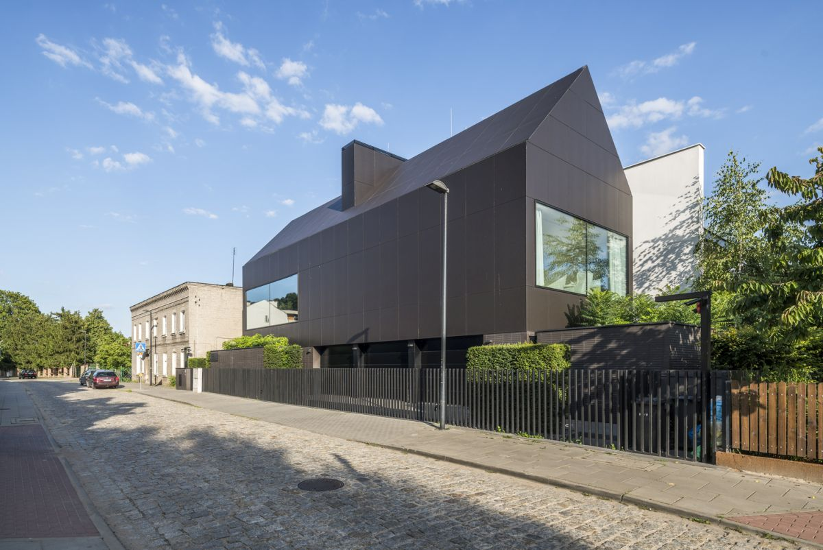 The gable roof and the dark exterior give this section of the house a distinctive contemporary look
