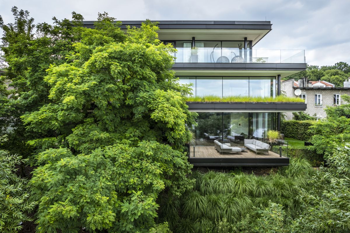 The riverside house has expansive terraces on all the floors