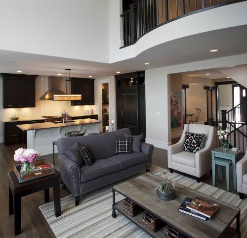 High ceiling living room with black furniture