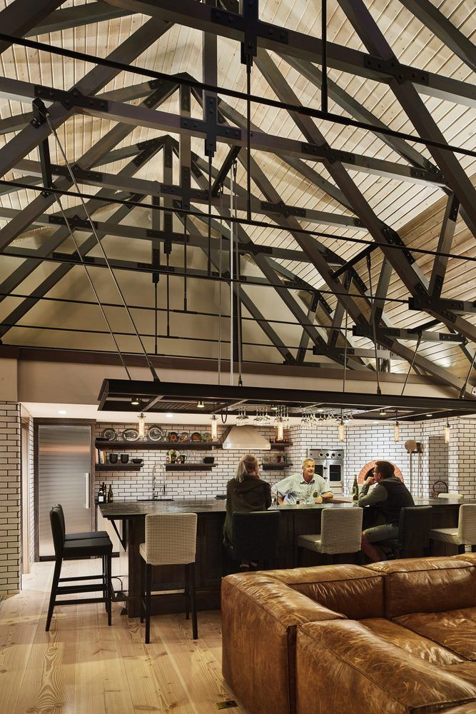 A high ceiling and expose trusses enhance the open feeling of the great room.