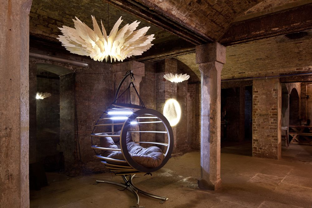 The Hive chair paired with paper winged chandeliers from Daniel Latorre Cruz.