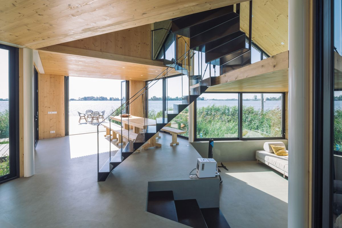 The origami-inspired staircase is actually very slender and doesn't obstruct the views
