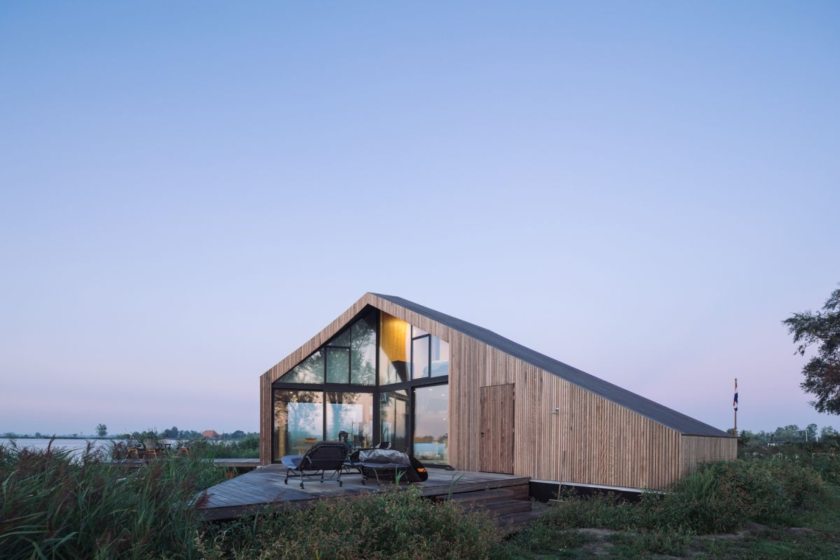 The roofline extends down on one side, incorporating a more private section of the house