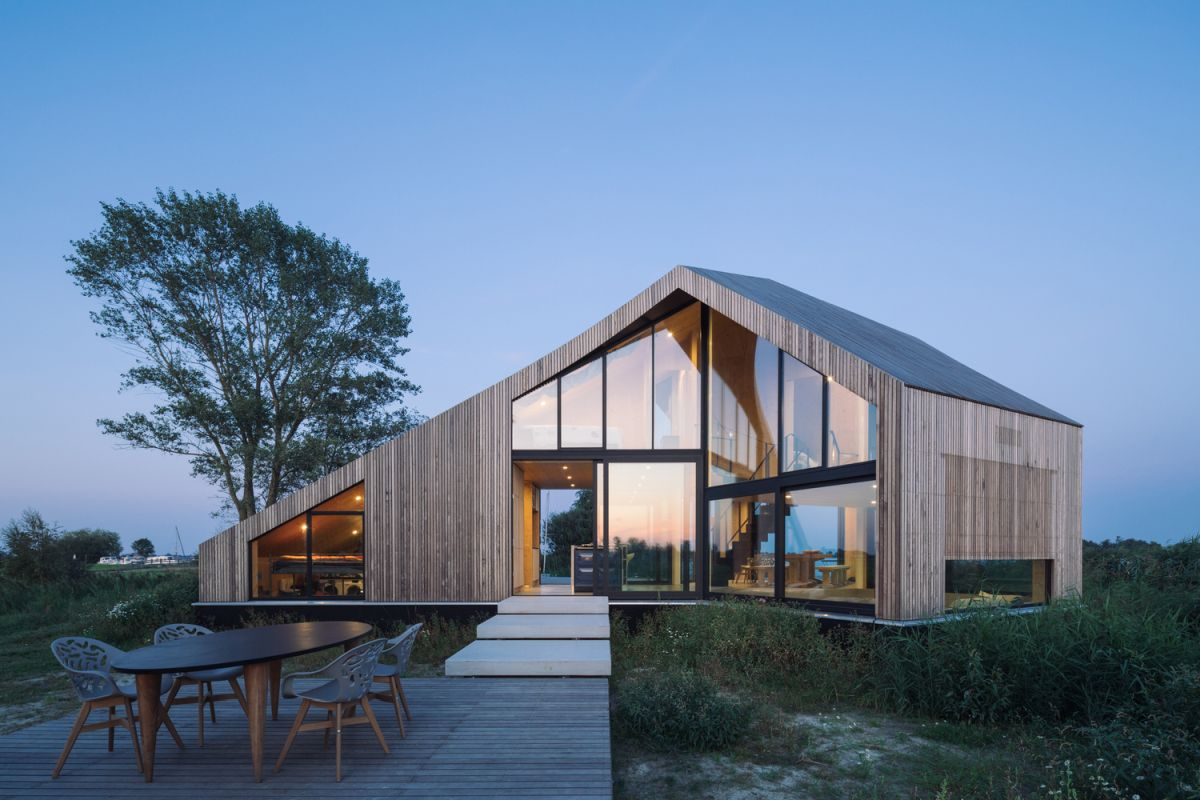 The house has a peculiar and asymmetrical design but maintains clean and simple lines throughout