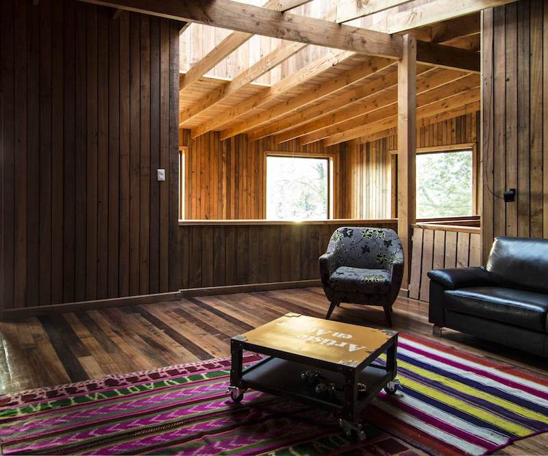 The interior walls, floor and ceiling and lined with reclaimed wood boards
