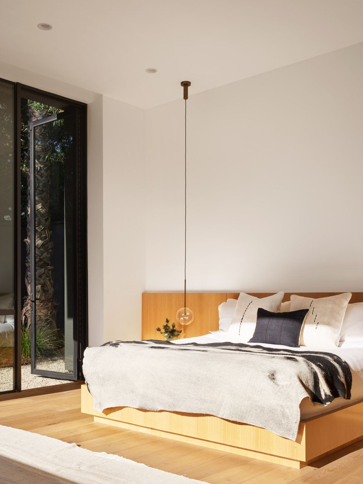 The master bedroom is placed at the far end of the volume and has its own private outdoor area