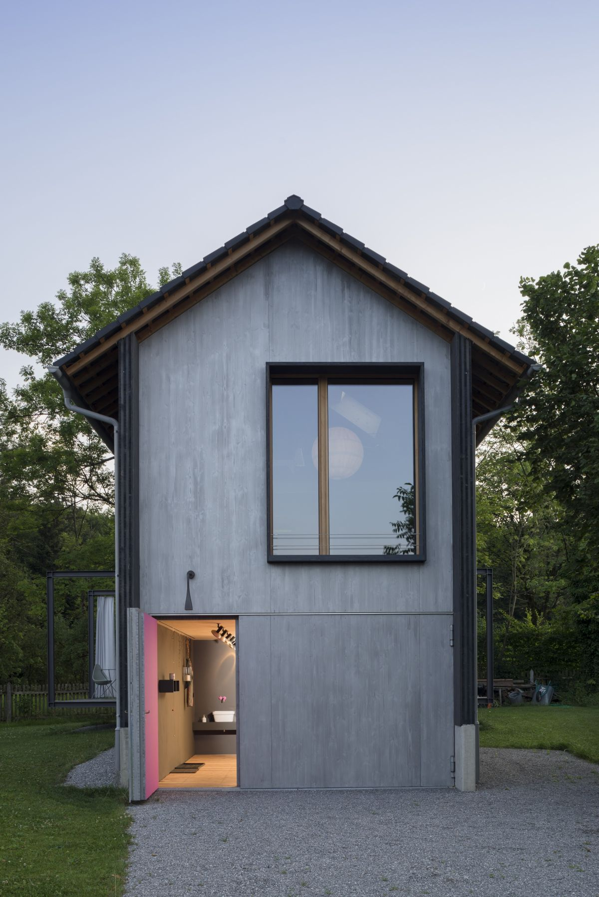 The front door is adjacent to the garage and can seamlessly blend into the facade when closed