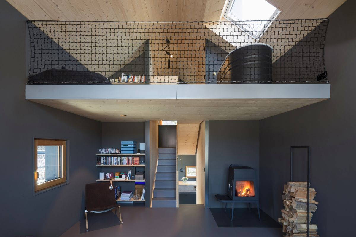 A wood-burning stove adds a warm and cozy touch to the living area
