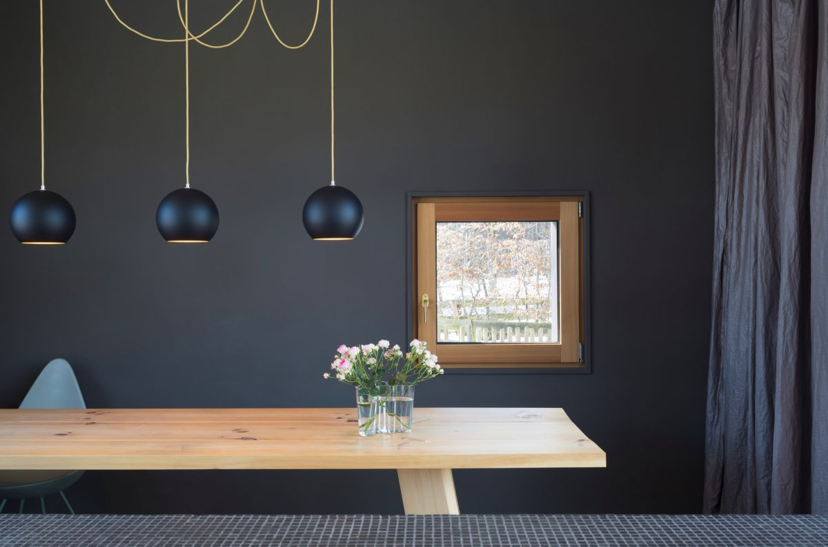 The black interior walls give the house an elegant and modern vibe