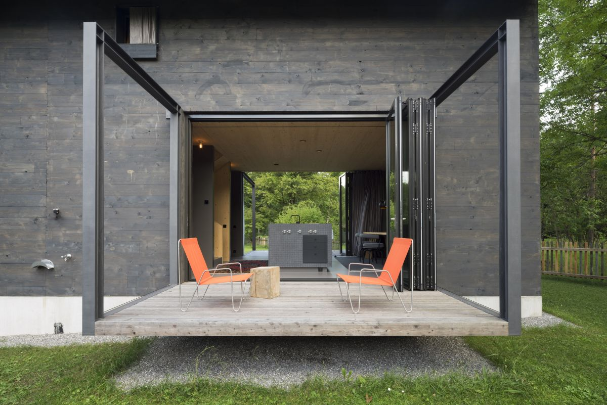 An elevated terrace sits at the same level as the ground floor areas, making the transition seamless