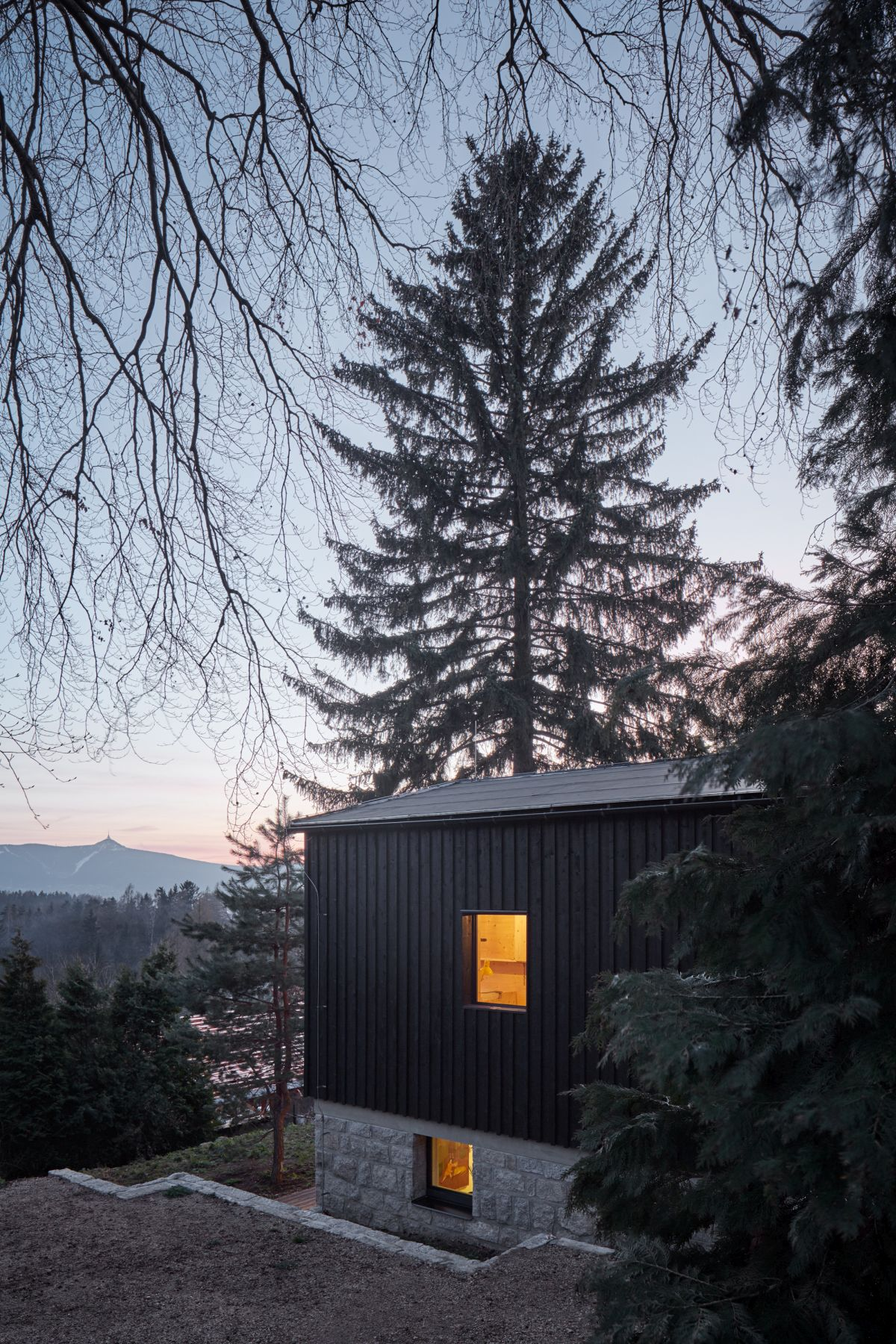 The house overlooks a beautiful valley and was designed to take advantage of the view