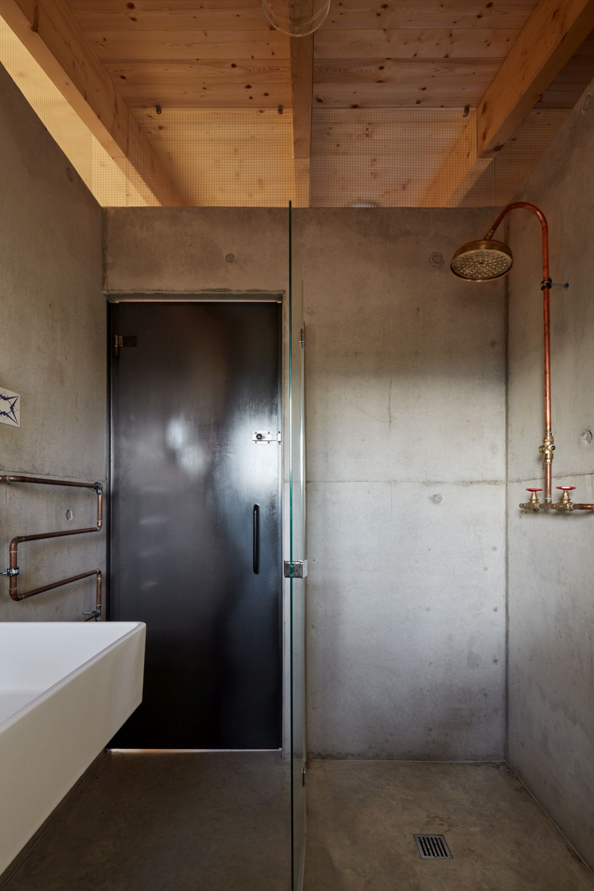 There's definitely a stronger industrial vibe in spaces like this bathroom compared to some of the other rooms