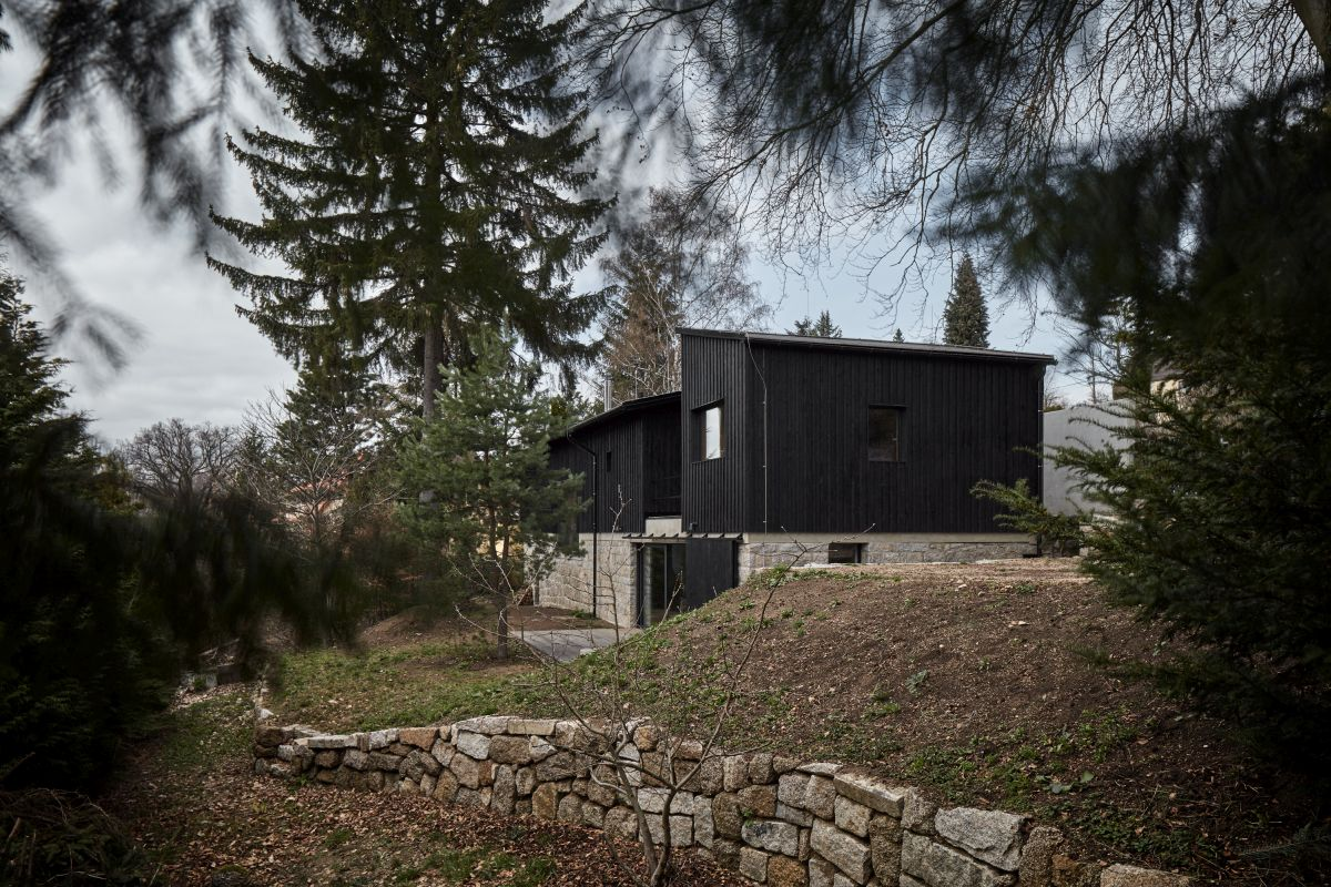 The house is built on top of the old structure's basement level which is made out of stone