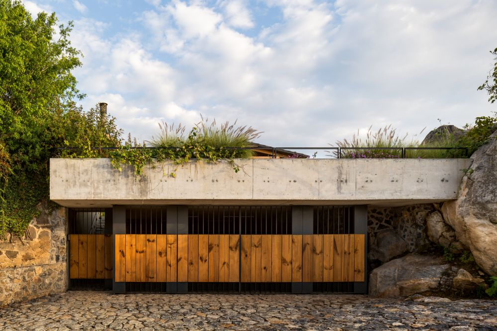 The private areas of the house are clustered on a lower level, partially underground