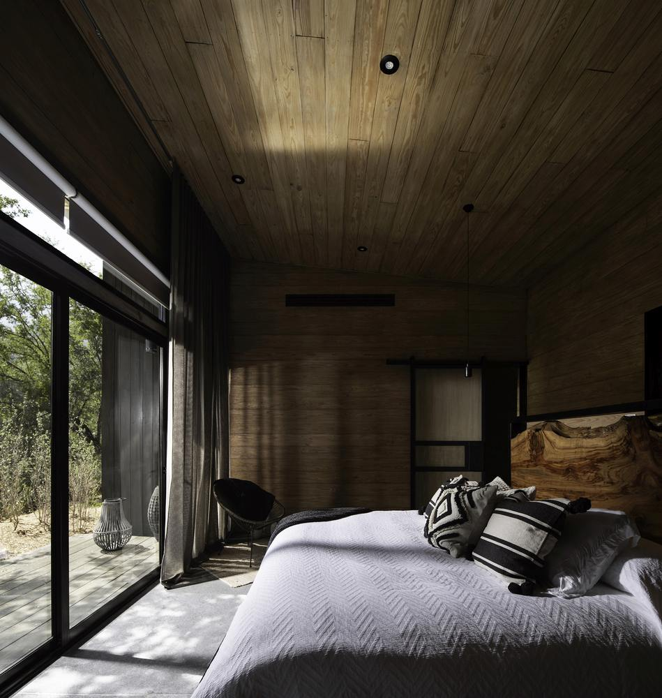 The bedrooms are clustered into a separate section of the cabin, away from the social areas